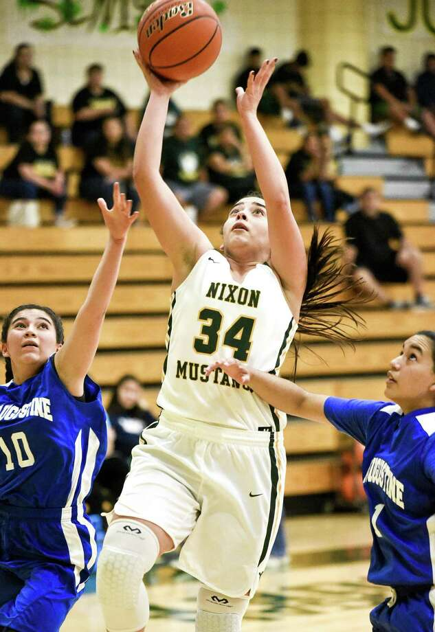 Ashley Pena scored nine points in Nixon's 50-6 victory over St. Augustine Saturday. A day after their rival Martin held Brooks Academy to its fewest recorded points over the past 12 seasons in a 70-6 win, the Lady Mustangs did the exact same thing in their first game. Photo: Danny Zaragoza /Laredo Morning Times / Laredo Morning Times