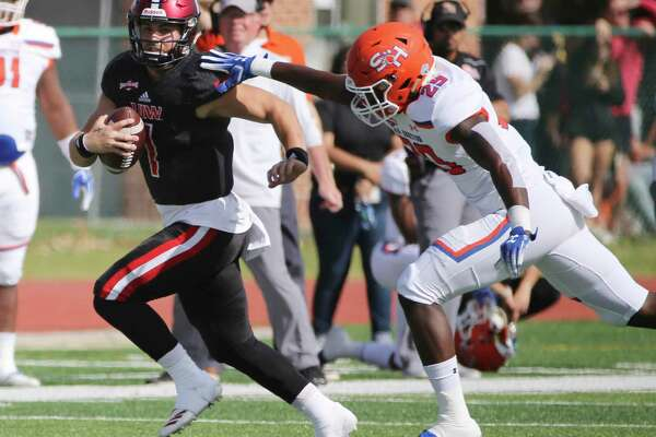 UIW quarterback Jon Copeland runs from Sam Houston State's Danzell Sims in a game this month at Benson Stadium.