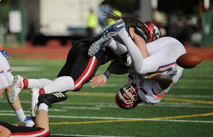 University of Incarnate Word's Luke Termin (11) flips over Sam Houston State quarterback Ty Brock (11) to force a fumble and eventual return for a touchdown in the third quarter during their football game at Benson Stadium at UIW on Saturday, Nov. 3, 2018. (Kin Man Hui/San Antonio Express-News)