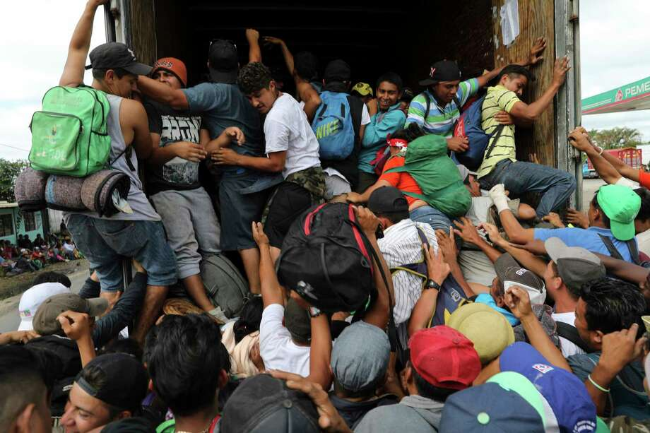 Central American migrants, part of the caravan hoping to reach the U.S. border, jump in a truck for a ride, in Isla, Veracruz state, Mexico, Saturday, Nov. 3, 2018. (AP Photo/Rodrigo Abd) Photo: Rodrigo Abd / Copyright 2018 The Associated Press. All rights reserved.
