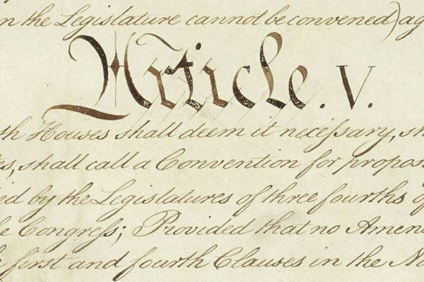 This photo made available by the U.S. National Archives shows a portion of the United States Constitution with the title of Article V. For the past two centuries, constitutional amendments have originated in Congress, where they need the support of two-thirds of both houses, and then the approval of at least three-quarters of the states. But under a never-used second prong of Article V, amendments can originate in the states. (National Archives via AP)