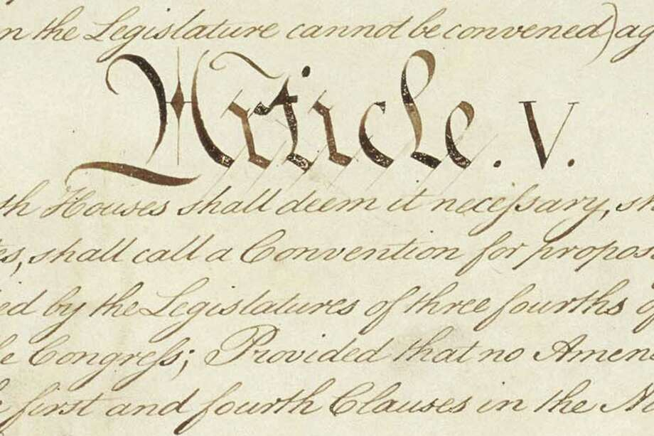 This photo made available by the U.S. National Archives shows a portion of the United States Constitution with the title of Article V. For the past two centuries, constitutional amendments have originated in Congress, where they need the support of two-thirds of both houses, and then the approval of at least three-quarters of the states. But under a never-used second prong of Article V, amendments can originate in the states. (National Archives via AP) / National Archives