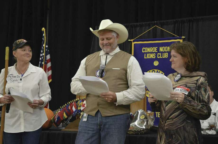 There was quite a bit of snickering during the dramatic reading of 'The Elevator' at last week's Conroe Noon Lions Club's — Wicked Wednesday festivities. Pictured from left are Catherine Prestigiovanni, Scott Perry, Melissa Bessey.
