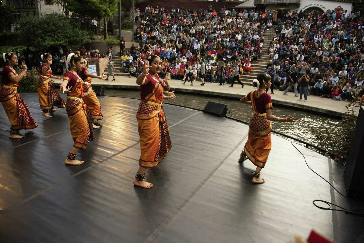 Members of Kaveri Tatya Yoga dance during the Diwali San Antonio Festival of Lights at La Villita and the Arneson River Theatre on Saturday, Nov. 3, 2018. Diwali is India's most important holiday and celebrates the victory of good over evil.