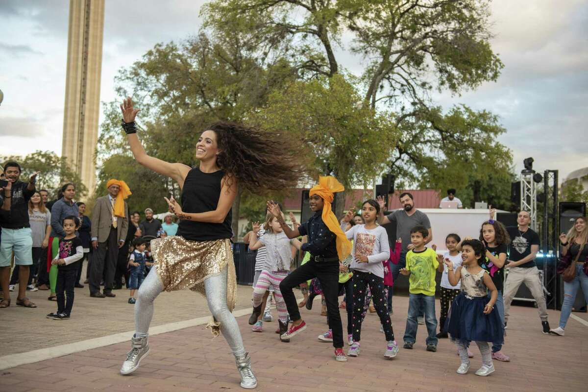 Da vida La Hood leads a dance as members of the public follow during the Diwali San Antonio Festival of Lights at La Villita and the Arneson River Theatre. Diwali is India's most important holiday.