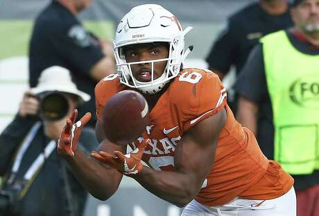 Longhorn receiver Devin Duvernay hauls in a touchdown pass to put Texas ahead in the final minutes as Texas hosts West Virginia at DKR Stadium on November 3, 2018.
