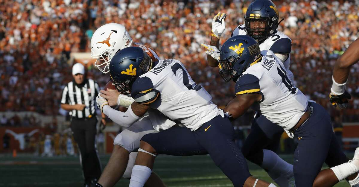 AUSTIN, TX - NOVEMBER 03: Kenny Robinson Jr. #2 of the West Virginia Mountaineers tackles Sam Ehlinger #11 of the Texas Longhorns short of the goal line in the second half at Darrell K Royal-Texas Memorial Stadium on November 3, 2018 in Austin, Texas. (Photo by Tim Warner/Getty Images)
