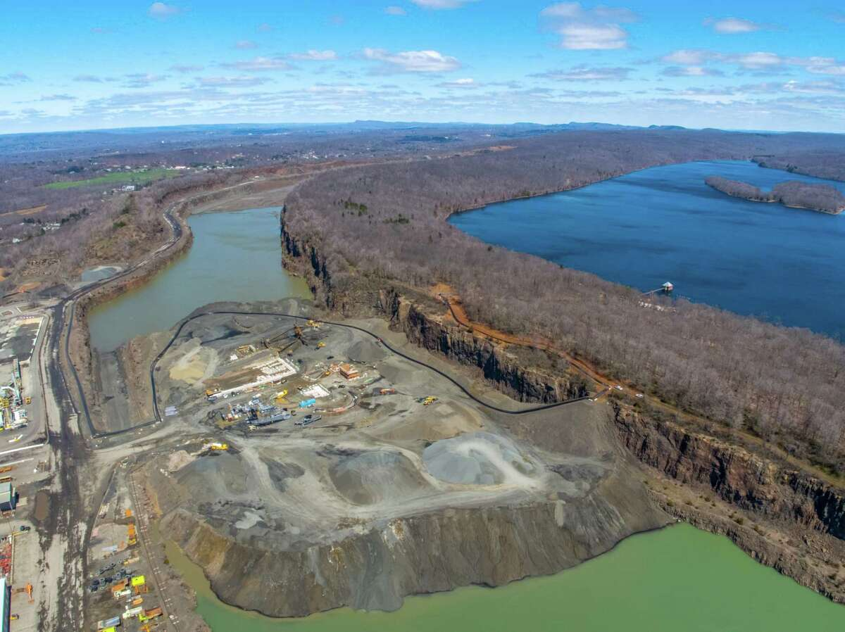 An aerial view of Tilcon Connecticut?'s North Branford quarry and the Regional Water Authority's Lake Galliard Reservoir (at right). Part of the $14.9 million project to repair a section of the tunnel and pipe system that brings water from the reservoir to a treatment facility in North Branford involvedcreating a temporary bypass system through the quarry to allow water to continue to flowing.