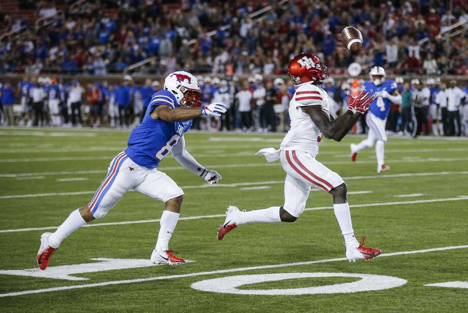 Houston wide receiver Marquez Stevenson (5) catches a pass as SMU defensive back Rodney Clemons (8) defends during the first half of an NCAA college football game Saturday, Nov. 3, 2018, in Dallas. Stevenson scored on the play. (AP Photo/Brandon Wade) Photo: Brandon Wade/Associated Press
