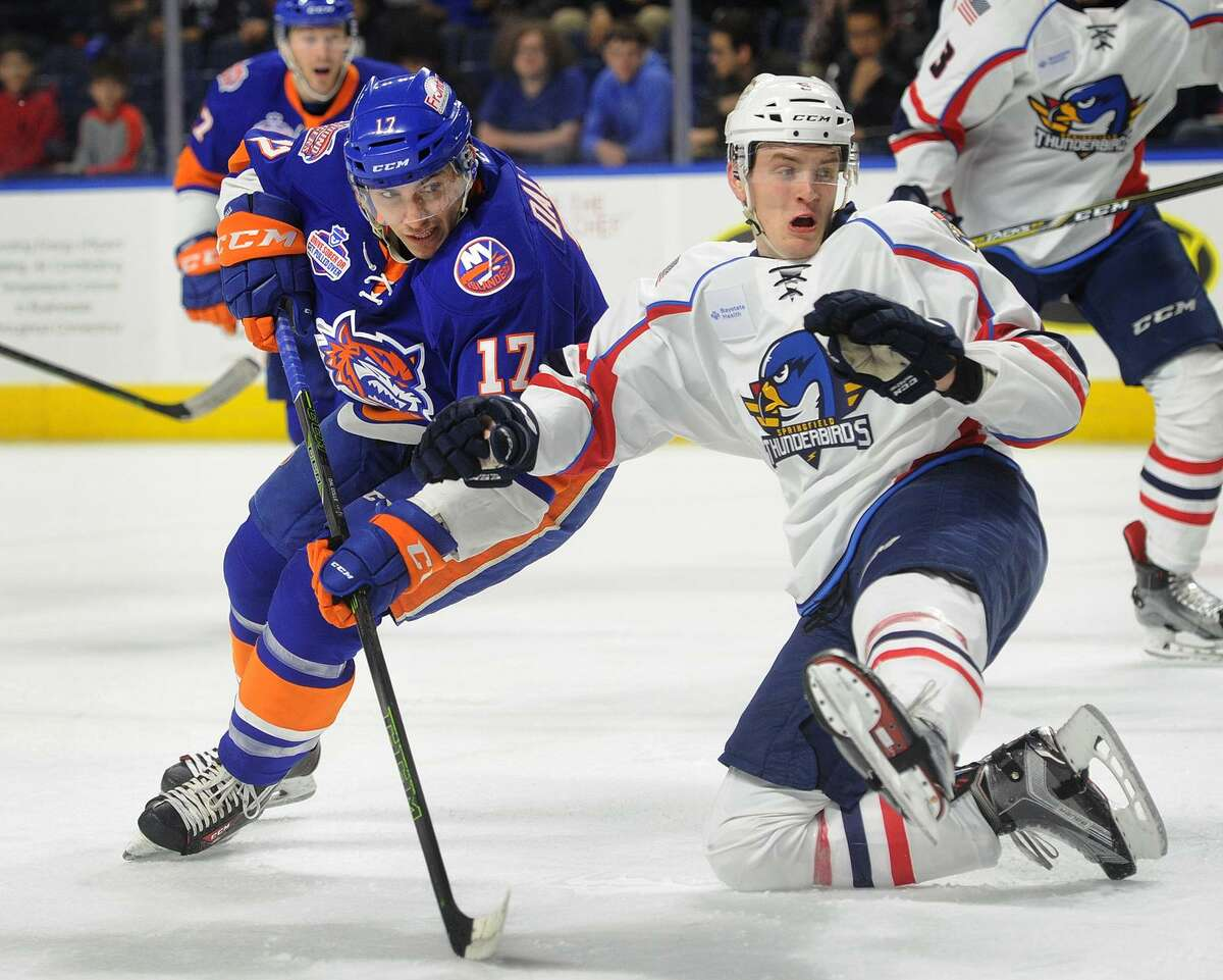 The Sound Tigers' Michael Dal Colle, left, is defended in front of the net by Springfield's Mike Downing during a game on April 4, 2017, at the Webster Bank Arena in Bridgeport.