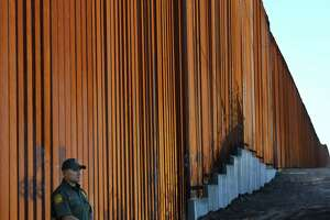 TOPSHOT - Border Patrol officers keep warch before U.S. Department of Homeland Security Secretary Kirstjen M. Nielsen inaugurates the first completed section of President Trumps 30-foot border wall in the El Centro Sector, at the US Mexico border in Calexico, California on October 26, 2018. (Photo by Mark RALSTON / AFP)MARK RALSTON/AFP/Getty Images