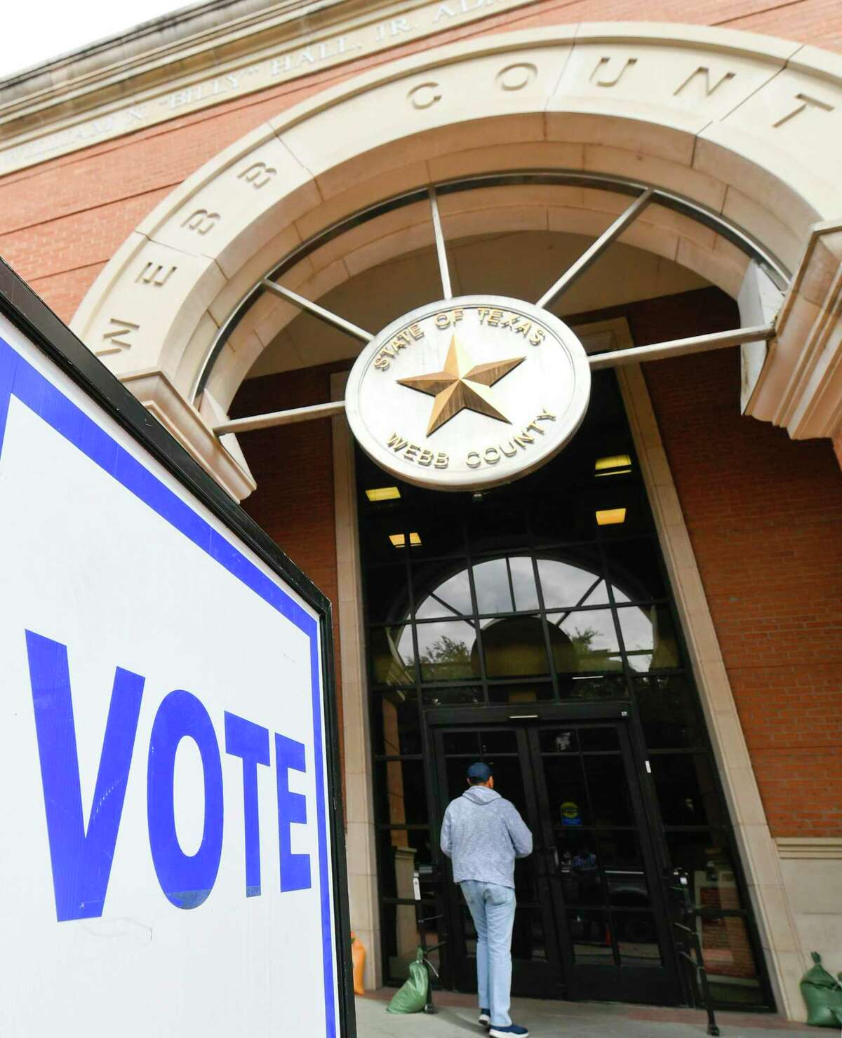 Laredoans enter the Webb County Billy Hall Jr. Administrative Building, the main early voting site, on Monday, Oct. 22, 2018. Early voting will continue through November 2, 2018.