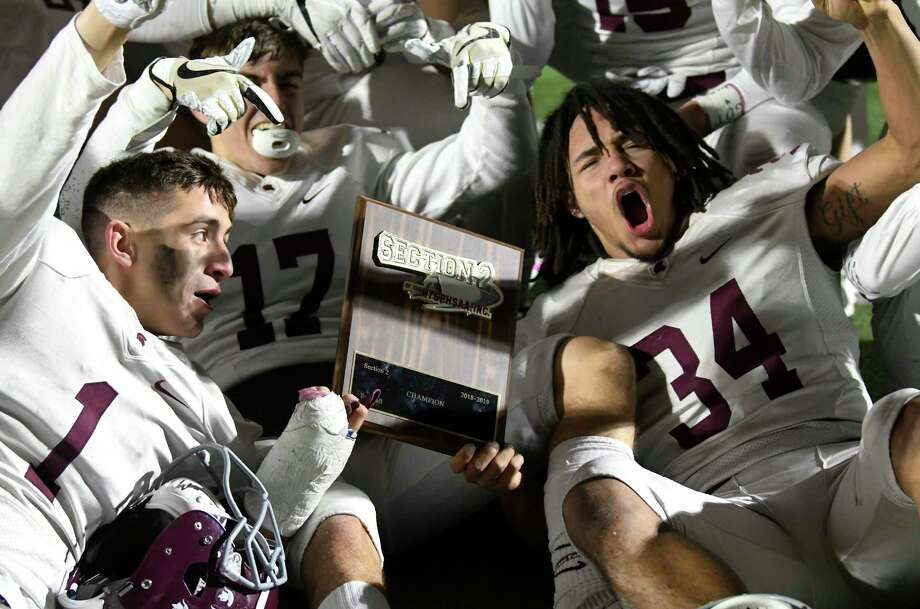 Burnt Hills-Ballston Lake players celebrate a 21-16 win against Queensbury during a Section II Class A High School Super Bowl football game Saturday, Nov. 3, 2018, in Clifton Park, N.Y. (Hans Pennink / Special to the Times Union) Photo: Hans Pennink / Hans Pennink