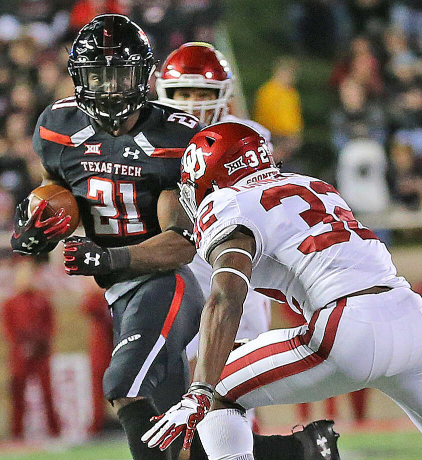 Texas Tech running back Da'Leon Ward (21) breaks to daylight against an Oklahome defender in Saturday night's Big 12 action. Photo: Wade H Clay