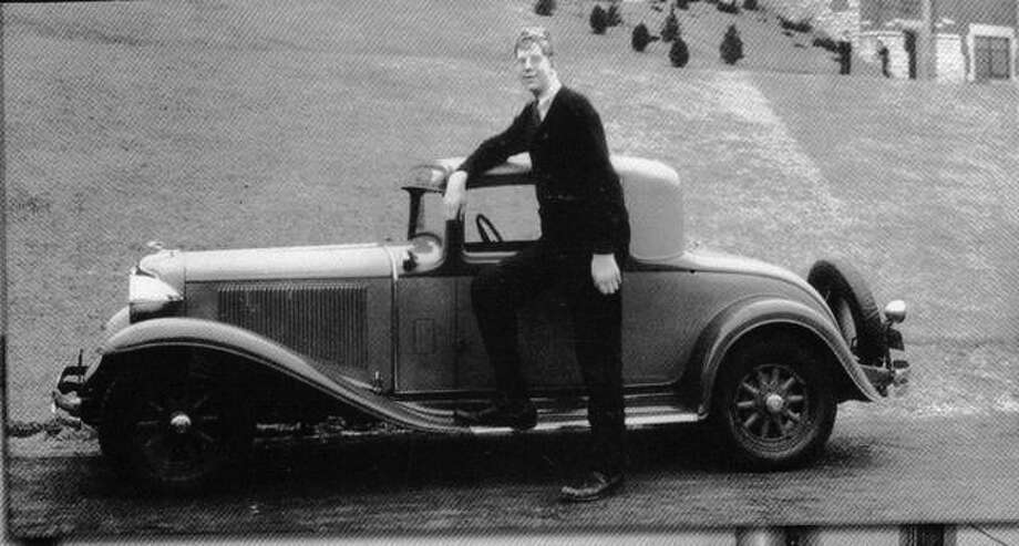 "It was every boy's dream — a classy new car — and Robert Wadlow was no exception. It was not his automobile, but he clearly enjoyed posing with the convertible in front of Alton High School. When he graduated from high school he was 8 feet, 4 inches, still less than an inch away from being the tallest man ever known. Robert entered Shurtleff College with a dream of becoming a lawyer. He dropped out of school and never returned to complete his education. Photo: From ""The Best Of Alton"" By Charlotte Stetson"