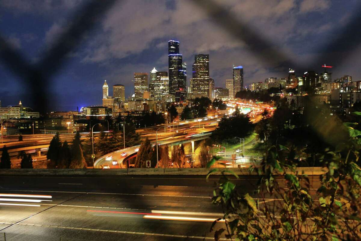 Buildings across Seattle and Bellevue, including the Columbia Tower (center) are lit up in blue Saturday night in honor of Microsoft co-founder and Seahawks owner Paul Allen, who died on Oct. 15, Nov. 3, 2018.