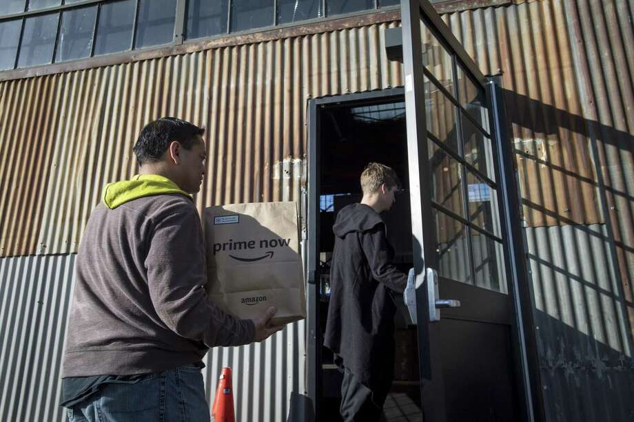 A contractor working for the Amazon Inc. Flex program delivers a package in San Francisco, California, U.S., on Tuesday, Oct. 30, 2018. Amazon is raising the minimum wage for all U.S. employees to $15 an hour, a move that was seen as a response to political pressures. However, Flex workers are not eligible because they're contractors. Photographer: David Paul Morris/Bloomberg Photo: David Paul Morris / Bloomberg / © 2018 Bloomberg Finance LP