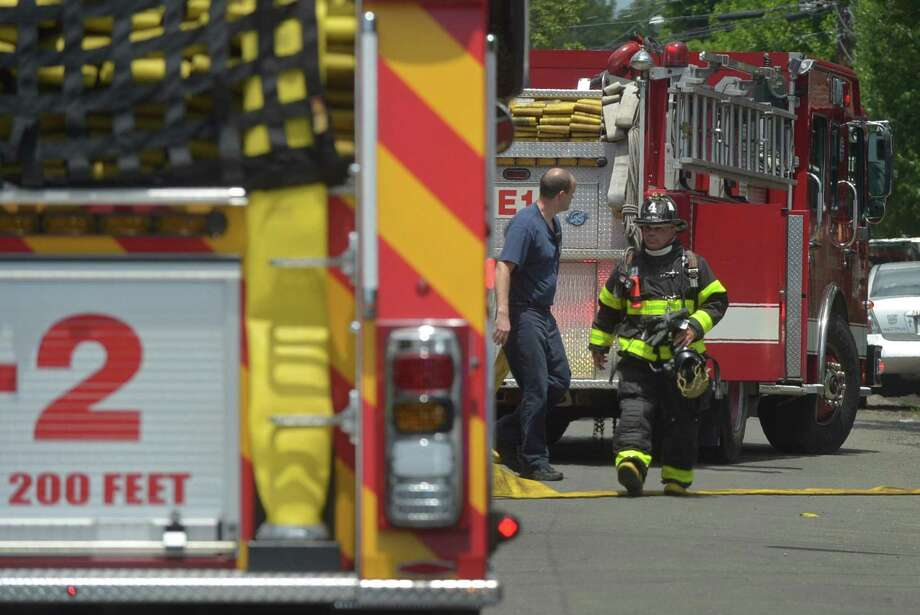 The Norwalk Fire Department responds to a small basement fire at 17 Slocum Street Saturday, July 1, 2017, in Norwalk, Conn. No one was hurt in the blaze. Photo: Erik Trautmann / Hearst Connecticut Media / Norwalk Hour