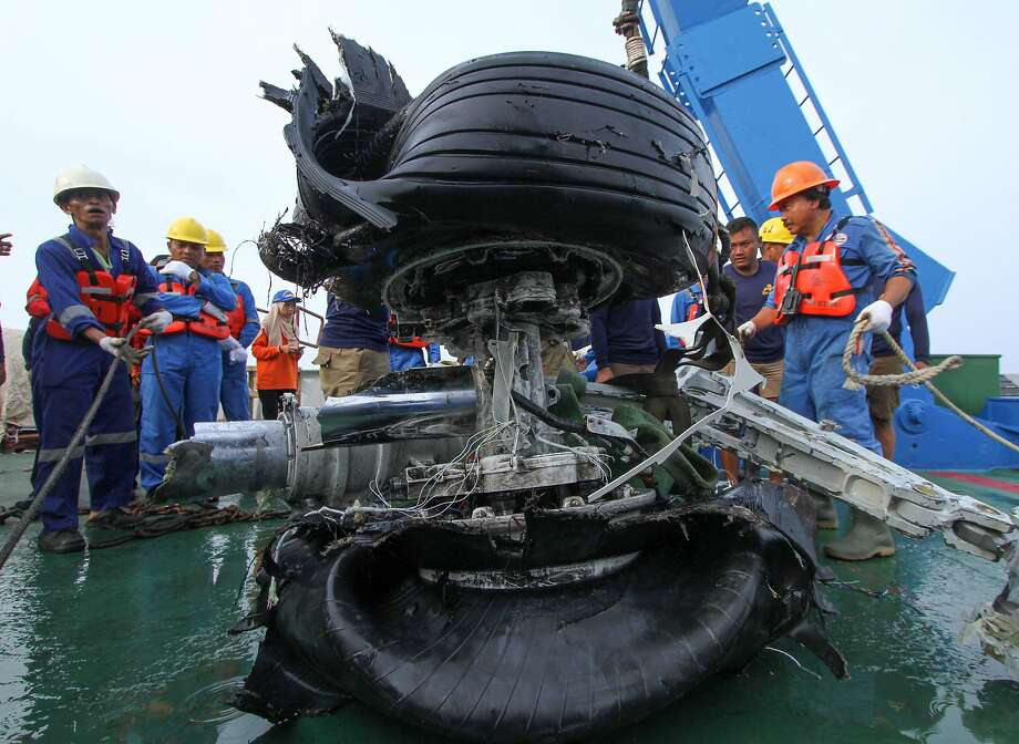 Workers secure a tire assembly recovered from the Lion Air jet that crashed after takeoff from Jakarta last Monday, killing all 189 people on board. The data recorder has been recovered. Photo: Azwar Ipank / AFP / Getty Images