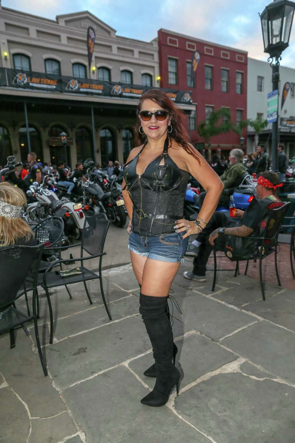 November 3, 2018: Bikers and seensters enjoy the festive atmosphere at the Lone Star Rally in Galveston, Texas.