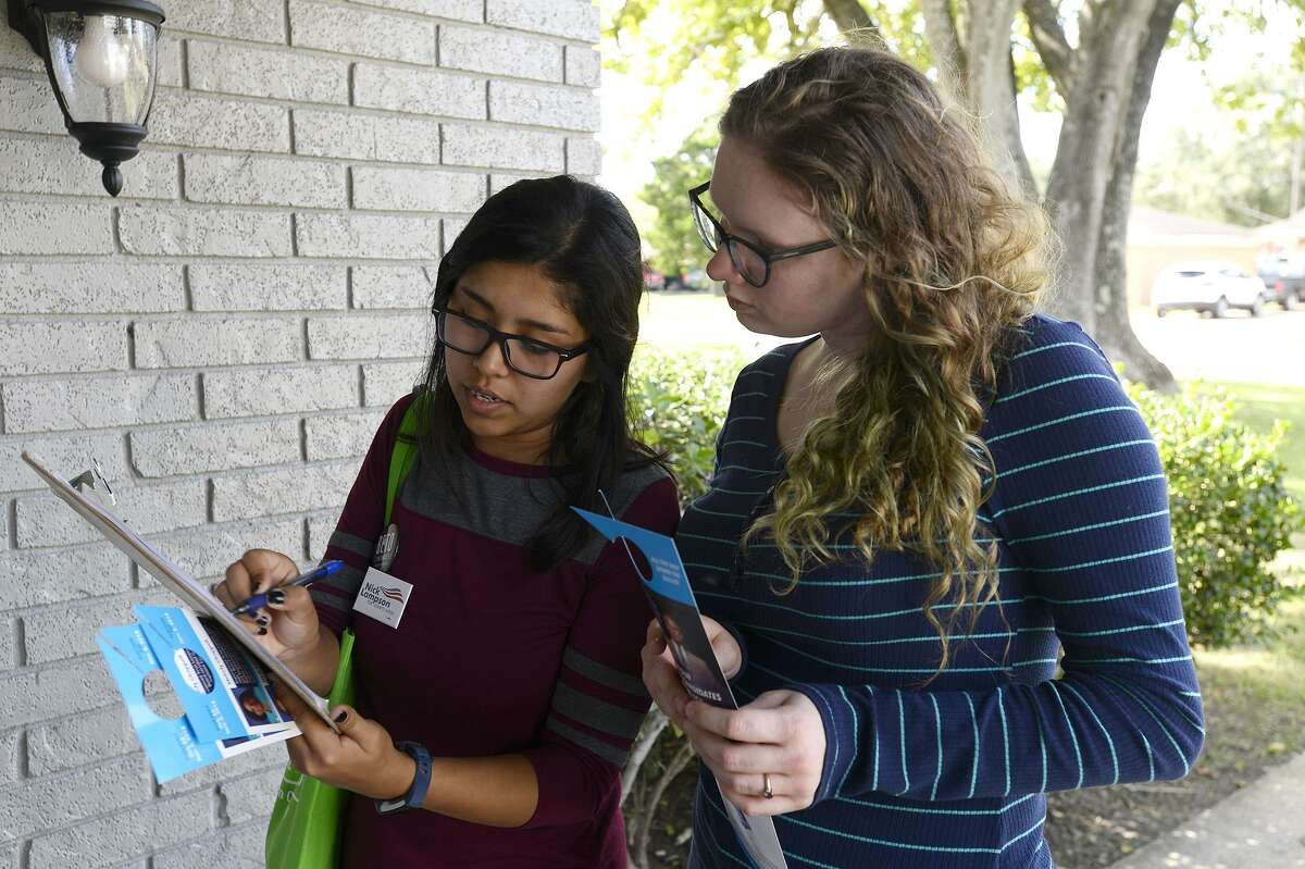 Maria Carrillo, left, and Lacy Gilbert campaign for the Jefferson County Democratic Party in Beaumont's Pear Orchard neighborhood on Saturday. Photo taken Saturday 11/3/18 Ryan Pelham/The Enterprise