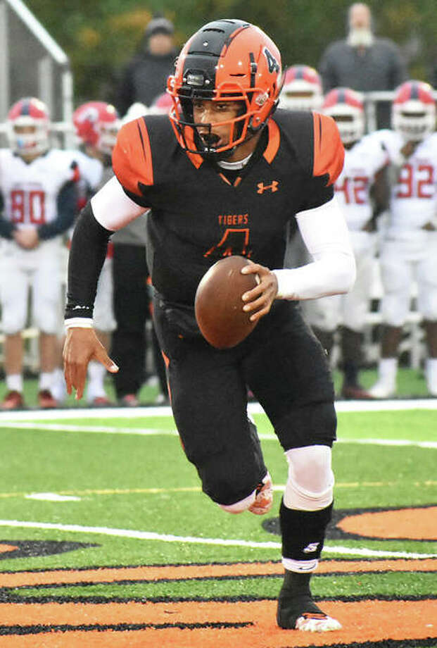 Edwardsville quarterback Kendall Abdur-Rahman takes off with ball during Saturday's Class 8A second-round playoff game against West Aurora at the District 7 Sports Complex in Edwardsville. Photo: Matt Kamp / Hearst Illinois