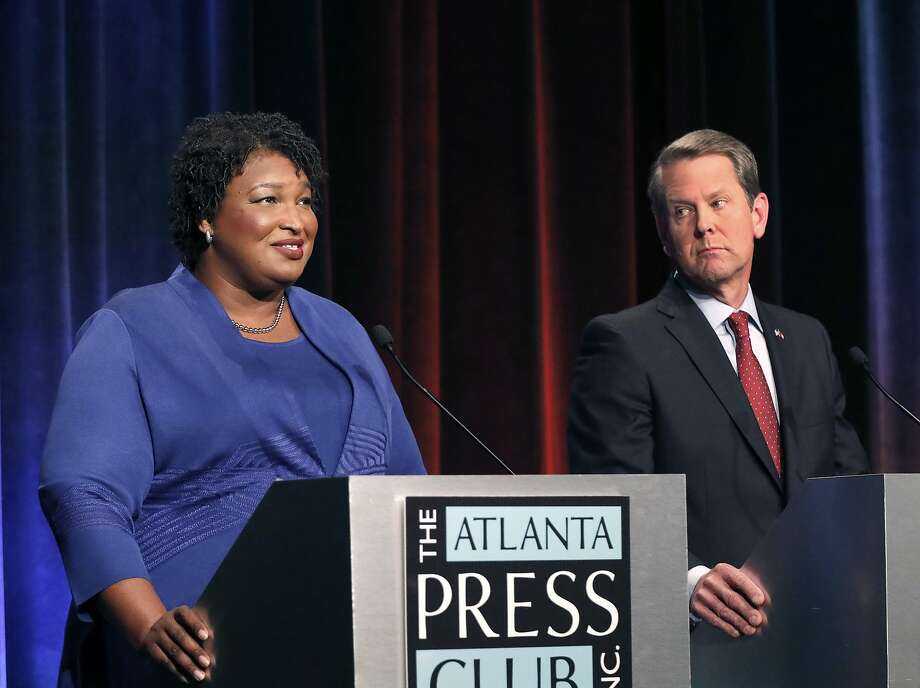 FILE - In this Tuesday, Oct. 23, 2018 file photo, Democratic gubernatorial candidate for Georgia Stacey Abrams, left, speaks as her Republican opponent Secretary of State Brian Kemp looks on during a debate in Atlanta. This year's midterms seem to be unlike any other that has happened before it, with key issues dividing voters. Photo: John Bazemore / Associated Press