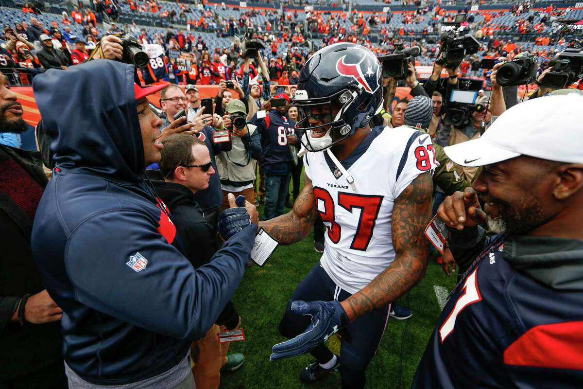Houston Texans wide receiver Demaryius Thomas (87) greeets his friends and family on the sidelines before an NFL football game against the Denver Broncos at Broncos Stadium at Mile High on Sunday, Nov. 4, 2018, in Denver.