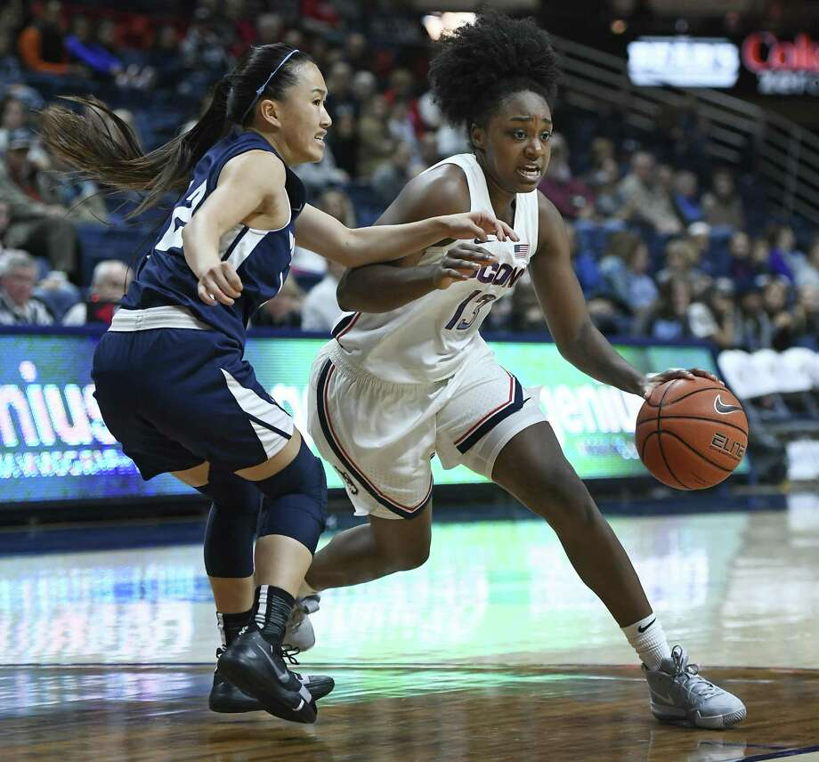 UConn's Christyn Williams, right, drives past Vanguard's Victoria Chea during the second half on Sunday's exhibition game in Storrs. Photo: Jessica Hill / Associated Press / Copyright 2018 The Associated Press. All rights reserved