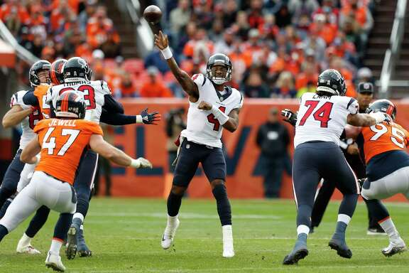 Houston Texans quarterback Deshaun Watson (4) throws a pass against the Denver Broncos during the first quarter of an NFL football game at Broncos Stadium at Mile High on Sunday, Nov. 4, 2018, in Denver.