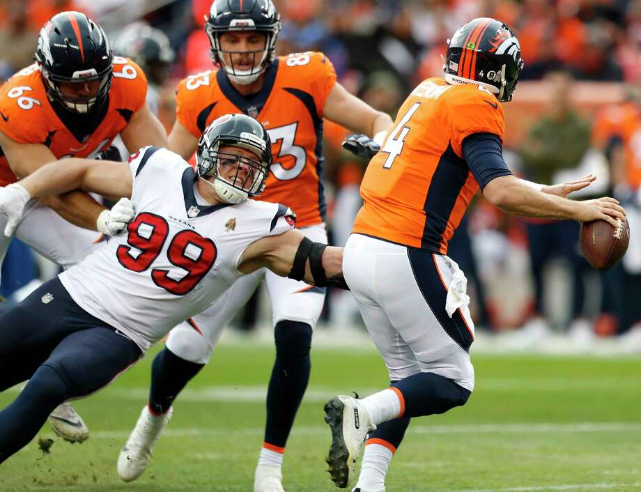 Houston Texans defensive end J.J. Watt (99) pressures Denver Broncos quarterback Case Keenum (4) as Keenum threw an incomplete pass during the first quarter of an NFL football game at Broncos Stadium at Mile High on Sunday, Nov. 4, 2018, in Denver. Photo: Brett Coomer, Staff Photographer / © 2018 Houston Chronicle