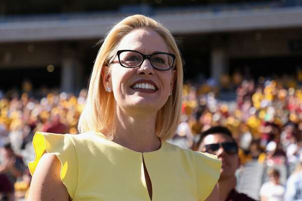 TEMPE, AZ - NOVEMBER 03: Democrat U.S. Senate candidate Kyrsten Sinema participates in the pregame coin toss before the game between the Utah Utes and the Arizona State Sun Devils at Sun Devil Stadium on November 3, 2018 in Tempe, Arizona. Sinema is running against two-term congresswoman Martha McSally. (Photo by Christian Petersen/Getty Images)