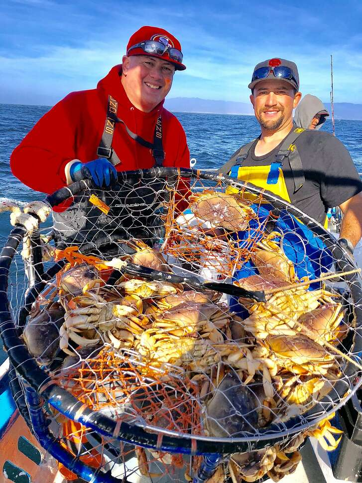 Peter Akimo and Mike Juanes show off of a pot full of Dungeness crab taken in 190 feet of water Sunday off San Gregorio on the Huli-Cat out of Pillar Point Harbor
