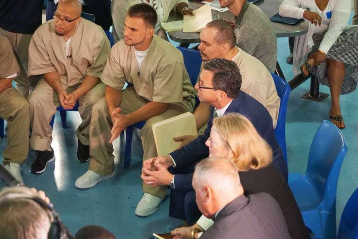 Gov. Dannel P. Malloy and first lady in a roundtable talk with Cheshire inmates in May.
