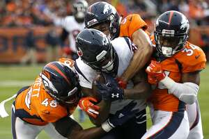 Houston Texans wide receiver Demaryius Thomas (87) is brought down by Denver Broncos linebacker Shaquil Barrett (48) and strong safety Will Parks (34) on a first down reception during the first quarter of an NFL football game at Broncos Stadium at Mile High on Sunday, Nov. 4, 2018, in Denver.