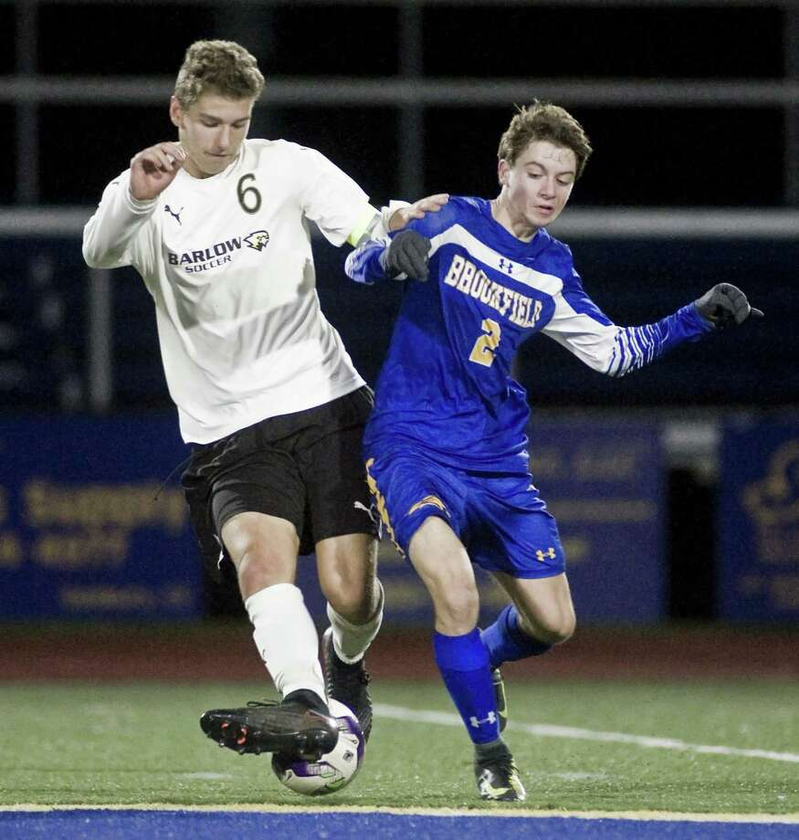 Joel Barlow High School midfielder Jack Warren, left, makes plenty of things happen from the middle of the pitch. Photo: Scott Mullin / For Hearst Connecticut Media / The News-Times Freelance