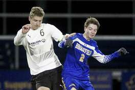 Joel Barlow High School midfielder Jack Warren, left, makes plenty of things happen from the middle of the pitch.