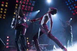 """(L-r): Gwilym Lee (Brian May), Rami Malek (Freddie Mercury) and Joe Mazzello (John Deacon) in """"Bohemian Rhapsody."""" MUST CREDIT: Alex Bailey, Twentieth Century Fox"""