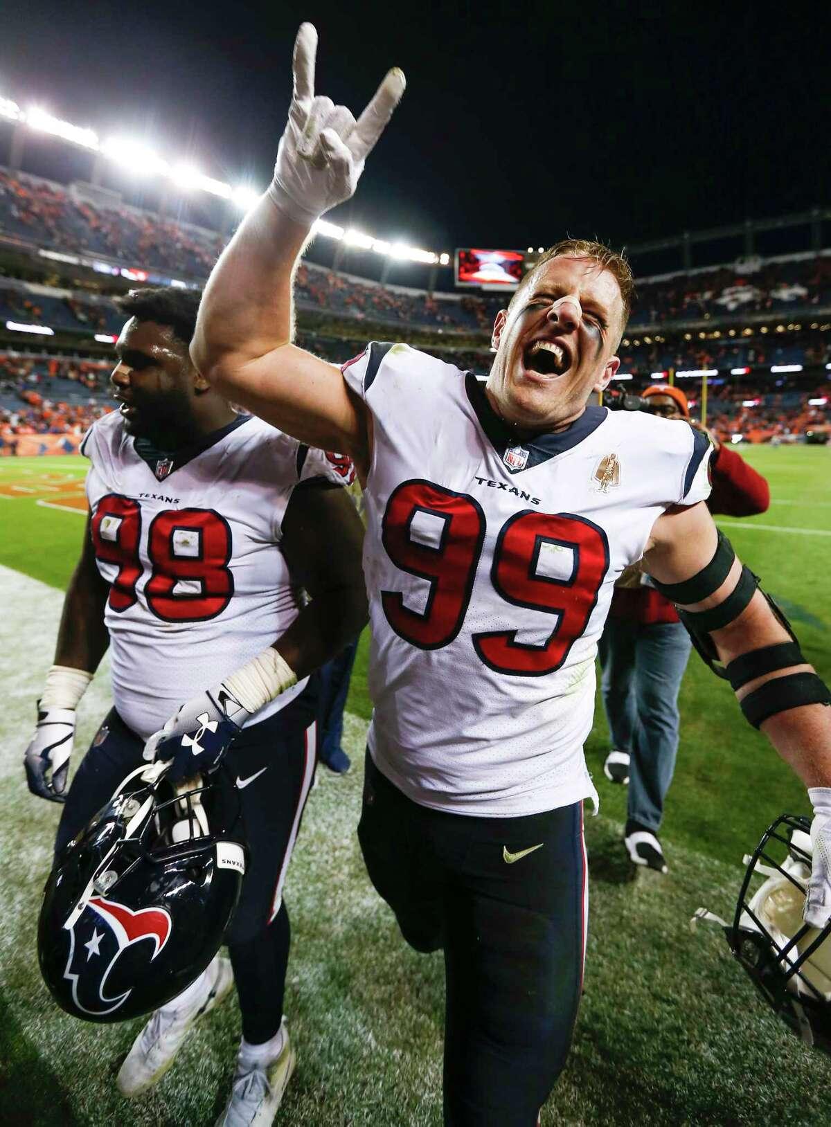 Houston Texans defensive ends D.J. Reader (98) and J.J. Watt (99) celebrate the Texans 19-17 win over the Denver Broncos in an NFL football game at Broncos Stadium at Mile High on Sunday, Nov. 4, 2018, in Denver.