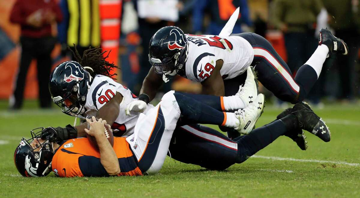 Houston Texans outside linebackers Jadeveon Clowney (90) and Whitney Mercilus (59) sack Denver Broncos quarterback Case Keenum (4) during the fourth quarter of an NFL football game at Broncos Stadium at Mile High on Sunday, Nov. 4, 2018, in Denver.