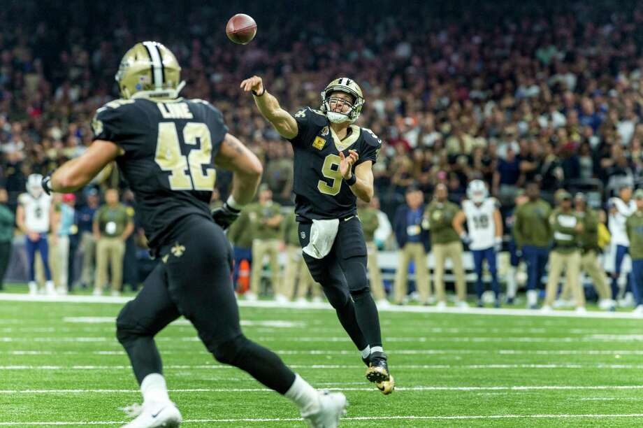 New Orleans Saints Quarterback Drew Brees  Throws A Pass To Teammate Zach Line
