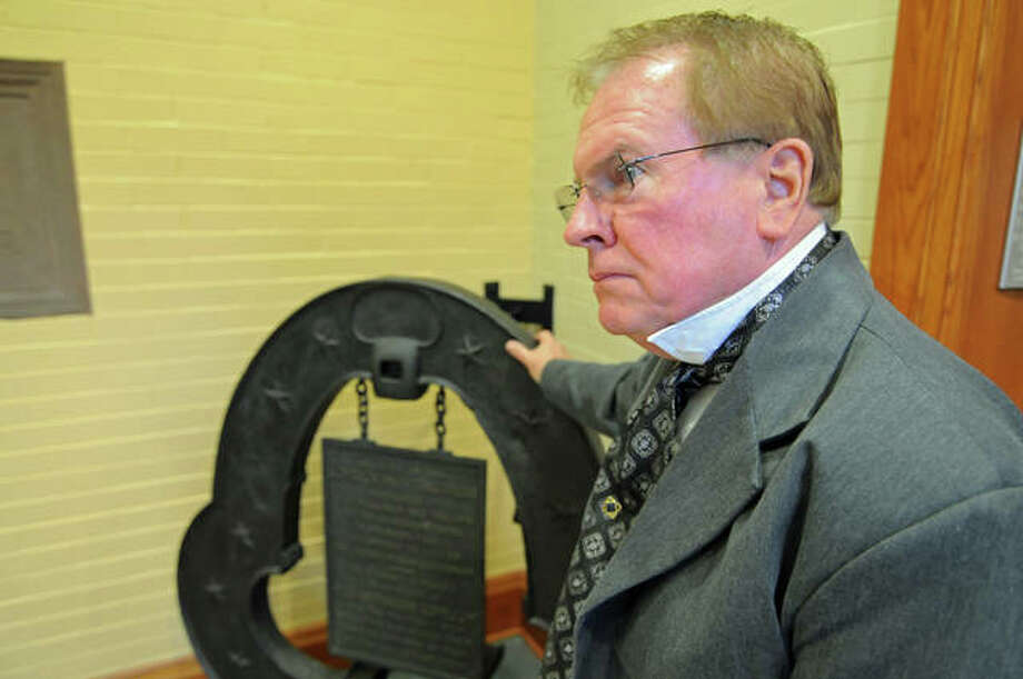 Elijah P. Lovejoy reenactor John Meehan poses by the original Lovejoy press. Photo: David Blanchette | For The Telegraph