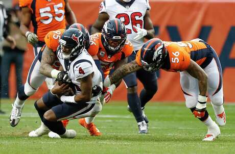 Houston Texans quarterback Deshaun Watson (4) is taken down by Denver Broncos defensive end Derek Wolfe (95) and linebacker Shane Ray (56) during the third quarter of an NFL football game at Broncos Stadium at Mile High on Sunday, Nov. 4, 2018, in Denver.