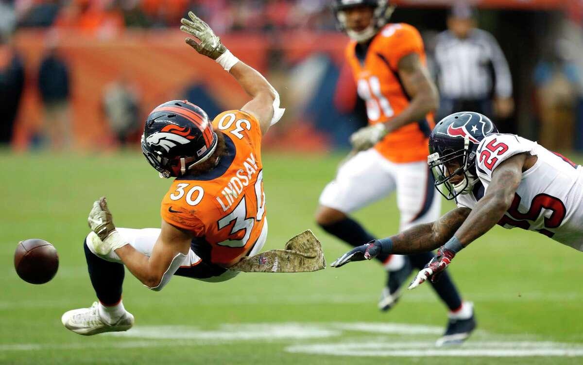 Houston Texans strong safety Kareem Jackson (25) breaks up a pass intended for Denver Broncos running back Phillip Lindsay (30) during the third quarter of an NFL football game at Broncos Stadium at Mile High on Sunday, Nov. 4, 2018, in Denver.