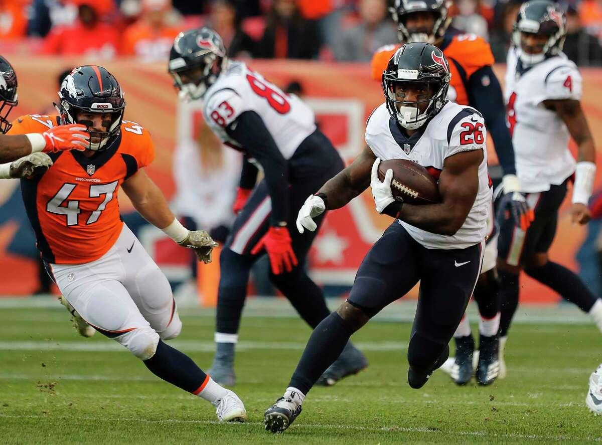 Houston Texans running back Lamar Miller (26) runs past Denver Broncos inside linebacker Josey Jewell (47) during the second quarter of an NFL football game at Broncos Stadium at Mile High on Sunday, Nov. 4, 2018, in Denver.