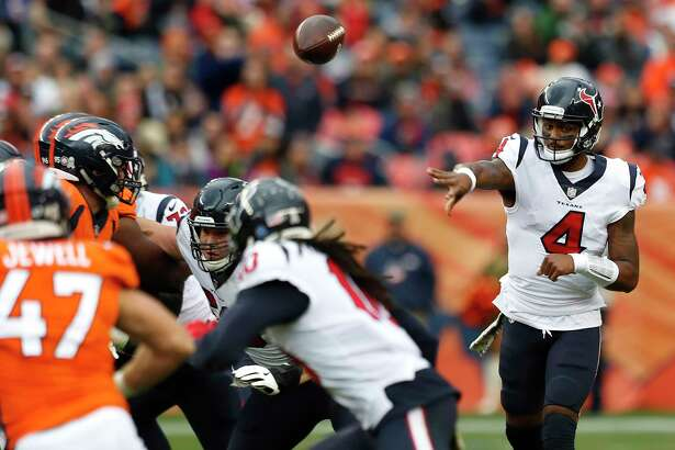Houston Texans quarterback Deshaun Watson (4) throws a pass against the Denver Broncos during the second quarter of an NFL football game at Broncos Stadium at Mile High on Sunday, Nov. 4, 2018, in Denver.