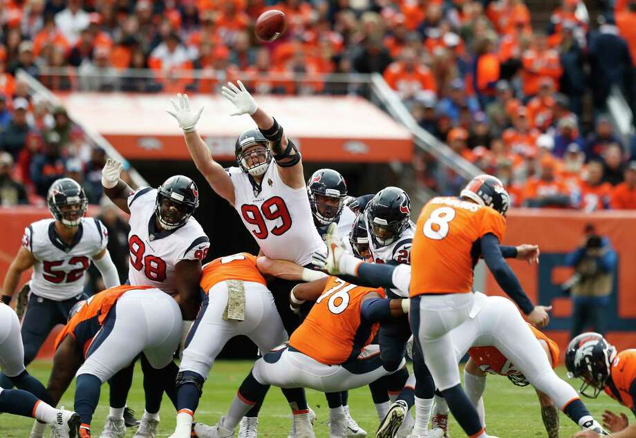 Houston Texans defensive end J.J. Watt (99) leaps to try and defend a field goal by Denver Broncos kicker Brandon McManus (8) during the first quarter of an NFL football game at Broncos Stadium at Mile High on Sunday, Nov. 4, 2018, in Denver. Photo: Brett Coomer, Staff Photographer / © 2018 Houston Chronicle