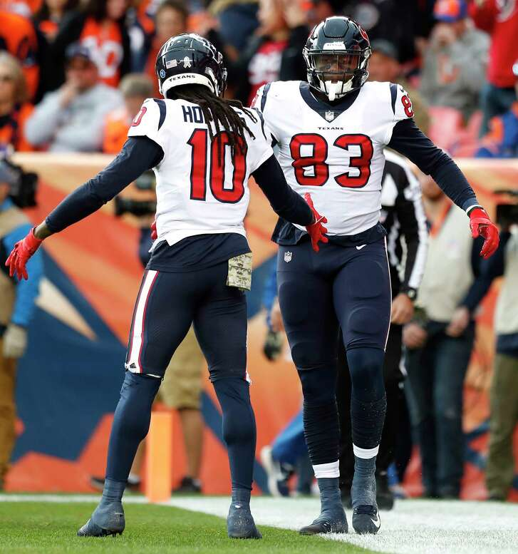 Houston Texans wide receiver DeAndre Hopkins (10) and tight end Jordan Thomas (83) celebrate Thomas' 7-yard touchdown reception during the first quarter of an NFL football game at Broncos Stadium at Mile High on Sunday, Nov. 4, 2018, in Denver.
