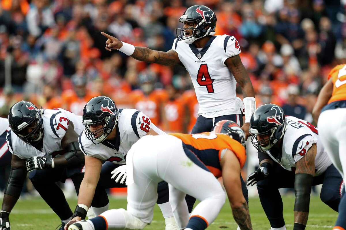 Houston Texans quarterback Deshaun Watson (4) calls signals at the line against the Denver Broncos during the second quarter of an NFL football game at Broncos Stadium at Mile High on Sunday, Nov. 4, 2018, in Denver.