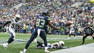 Seahawks wide receiver David Moore (83) misses a touchdown catch that was tipped out by Chargers corner back Casey Hayward Jr. (on the ground) in the second half of the Seahawks game against the LA Chargers, Sunday, Nov. 4, 2018 at CenturyLink Field.